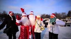 Happy, dancing and smiling Ded Moroz and Snow Maiden singing in camera. Stock Footage