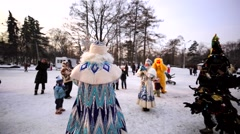 Ded Moroz and Snow Maiden sing using microphones. Stock Footage
