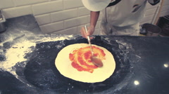 Chef preparing pizza in kitchen Stock Footage