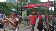 Runner takes selfie at Finish line of Ottawa Marathon - May 28th 2016 - stock footage