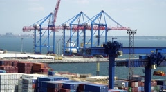 Sea port. Visible harbor cranes  cargo containers  automobiles - stock footage