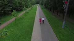 Aerial Slow Motion Video of a Couple in Love Walks in the Park Stock Footage