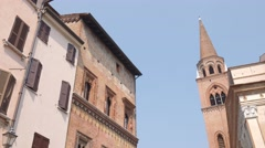 Ancient House of the Merchant and Saint Andreas bell tower in Mantua Stock Footage