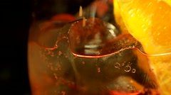 Closeup view, ice cocktail with tonic and orange Stock Footage