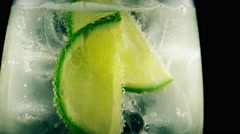 Refreshing summer cocktail with lime and tonic - stock footage