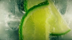 Cold cocktail with lime, tonic and ice, closeup Stock Footage