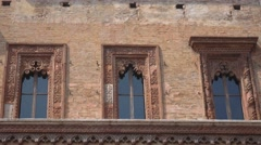 Windows of the ancient House of the Merchant in Piazza delle Erbe in Mantua Stock Footage