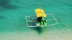 Top view of the traditional Philippine Banca boat moored at Puka Shell beach Stock Footage