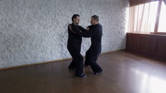 Training in the hall. Two men practicing the elements of tai chi. 4K Stock Footage
