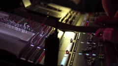 Male and woman hands using a two sound digital mixer at a concert Stock Footage