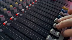 DJ Fingers control the sound on a mixer Stock Footage