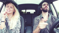 Fashion people singing in car driving happy - stock footage