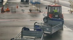 Preparing to unload luggage from the plane Stock Footage