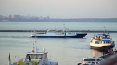 Pleasure boat with people floating away in the open sea. - stock footage