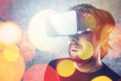 Man with virtual reality goggles watching 3d VR multimedia content Stock Photos