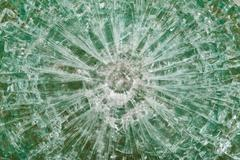 Bulletproof glass after the shooting with traces of bullets, test Stock Photos