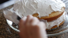 Child Putting Fluffy Frosting on White Birthday Cake 422 10bit, 4K Stock Footage