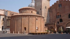 Rotonda di San Lorenzo church and clock tower in Piazza delle Erbe in Mantua Stock Footage