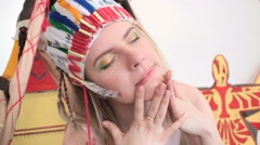 Girl with headband and make-up touching her face Stock Footage
