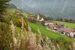 Autumnal view toward the little town of Acereto in Ahrntal Stock Photos