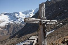 Old wooden crucifix long an high path in South Tyrol Stock Photos
