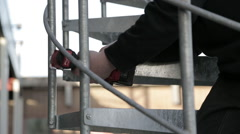 Close up of professional fasten rail on staircase Stock Footage