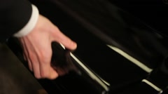 Opening grand piano - stock footage