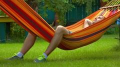 Man having rest in bright hammock 4K video Stock Footage