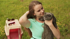 A girl holds a Scottish Fold cat Stock Footage