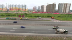 Camera flying along ring road freeway with driving vehicles. Aerial view Stock Footage