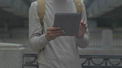 The guy with the tablet, the phone in the city, UHD Stock Footage