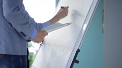 People stand in auditory near whiteboard and create draft of diagram Stock Footage