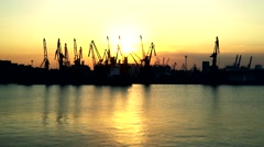 The ship stands for unloading at the seaport at sunset Stock Footage