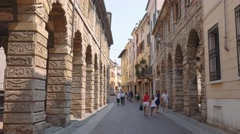 People walk in Via Pescheria, a street in Mantua city Center Stock Footage