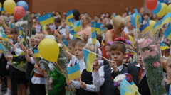 DNEPR, UKRAINE -Pupils waving the Ukrainian flags on the Stock Footage