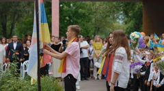DNEPR, UKRAINE -  Pupil up the Ukrainian flag on the school Stock Footage