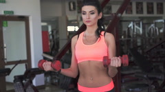Profile of a woman weightlifting in the gym. Slow motion Stock Footage