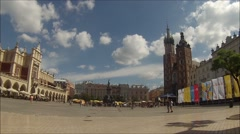 Rynek Glowny, Main market square in Krakow, Poland, with Baslica Mariacka in the Stock Footage