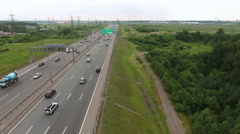 Aerial view at the ring highway. Camera flying across road. St. Petersburg Stock Footage