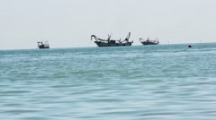 A few fishing boats to the horizon . Trawling Stock Footage