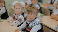 DNEPR, UKRAINE - First former pupils in national clothes sit Stock Footage