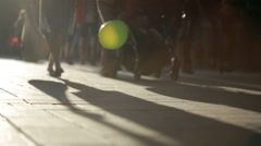 Silhouette of people walking in the city. long shadows - stock footage