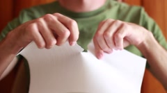 Man tearing a sheet of paper Stock Footage