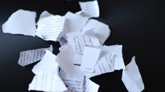 Teared pieces of paper on a table Stock Footage