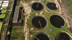 Circles of clarifiers on the earth and sedimentation tanks of wastewater plant Stock Footage