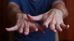Man with tremored hands Stock Footage