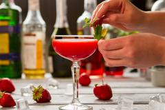 Coupe glass with red cocktail. Stock Photos
