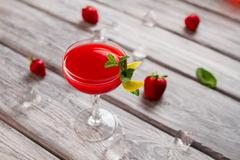 Bright red drink in glass. Stock Photos