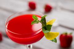 Glass with bright red drink. Stock Photos