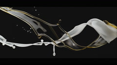 Milky liquid and oil twisting and falling. Slow Motion. Stock Footage